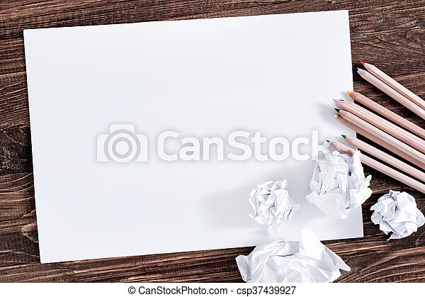paper on wooden background - csp37439927