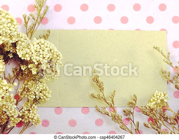 paper with dried flowers and space copy background