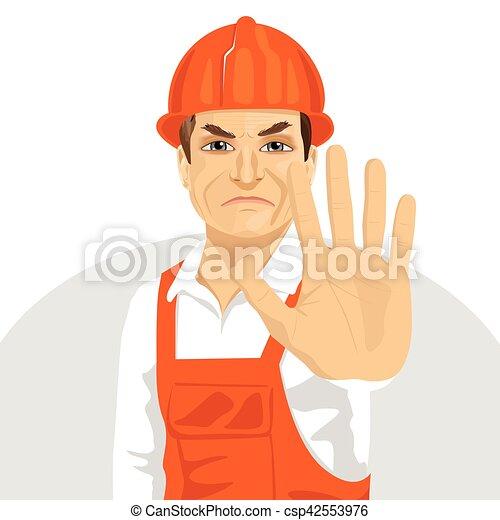 Un trabajador de carretera con sombrero duro mostrando gesto de alto - csp42553976
