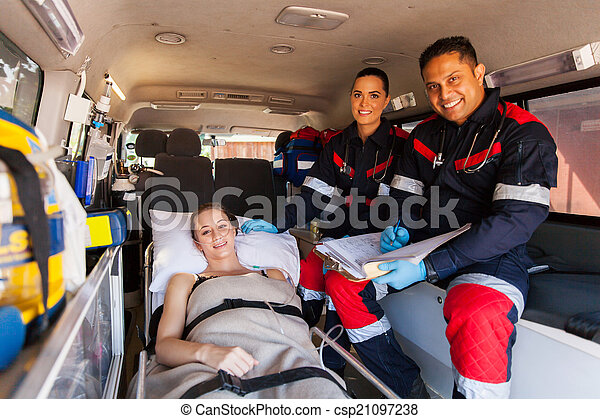 paramedic team and patient in ambulance - csp21097238