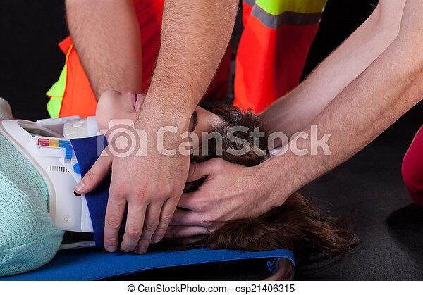 Paramedics using cervical collar - csp21406315