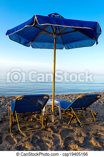 Parasols and chais-longue on the beach - csp19405166