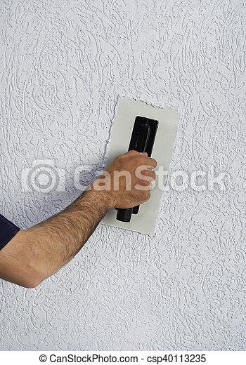 Plastando una pared - csp40113235
