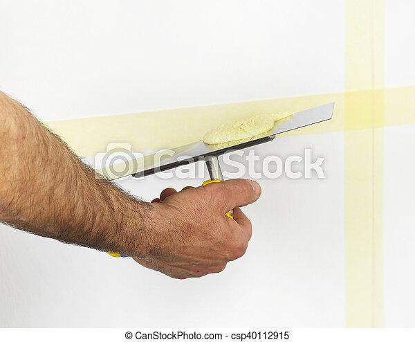 Plastando una pared - csp40112915