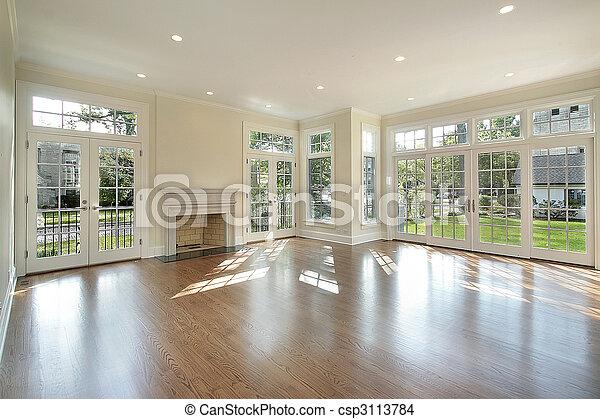 Sala de estar con paredes de ventanas - csp3113784
