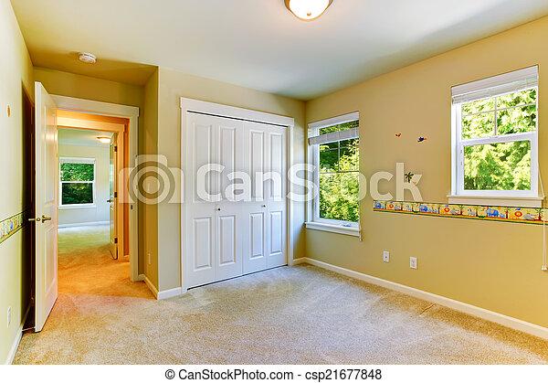 Un cuarto de niños vacío con paredes pintadas - csp21677848