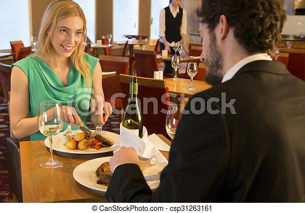 Una pareja joven en un restaurante - csp31263161