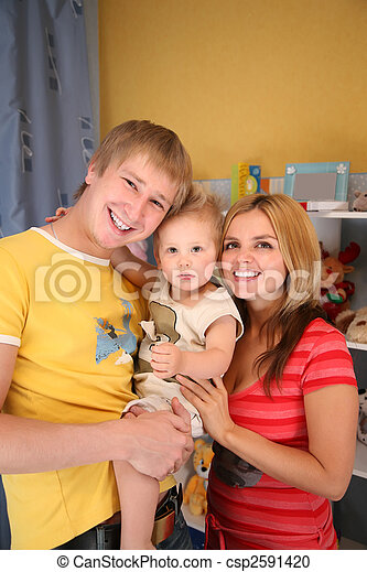 parents and son in playroom - csp2591420