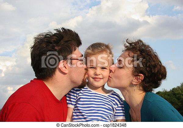 parents kiss son - csp1824348