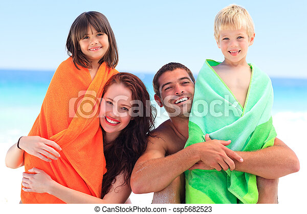 Parents with their children in towels - csp5682523