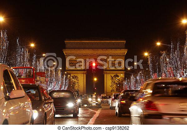 PARIS - JANUARY 1: Avenue des Champs Elysees and Triumph Arch at - csp9138262