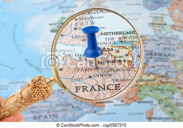 Paris map tack Magnifying glass over paris france map with