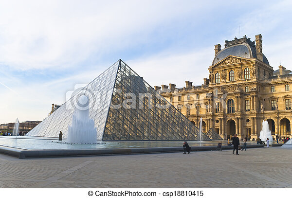 PARIS - March 20. Tourists enjoy the weather at the Louvre on Ma - csp18810415