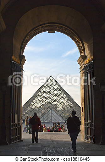 PARIS - March 20. Tourists enjoy the weather at the Louvre on Ma - csp18810445