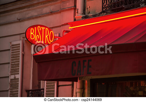 A neon sign and red awning of a typical parisian bistro stock image