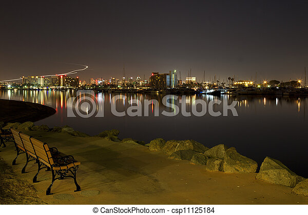 Park Bench On Waterfront At Night A Park Bench Sits By The Water At
