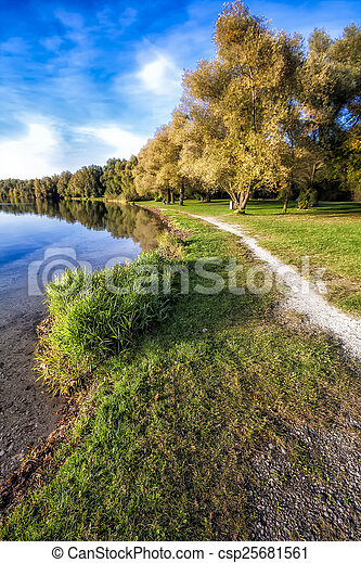 Park in Autumn Around a Lake - csp25681561