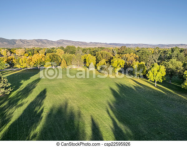 park in fall colors - aerial view - csp22595926