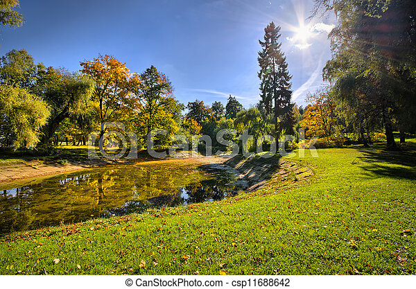 Park with pond during autumn - csp11688642