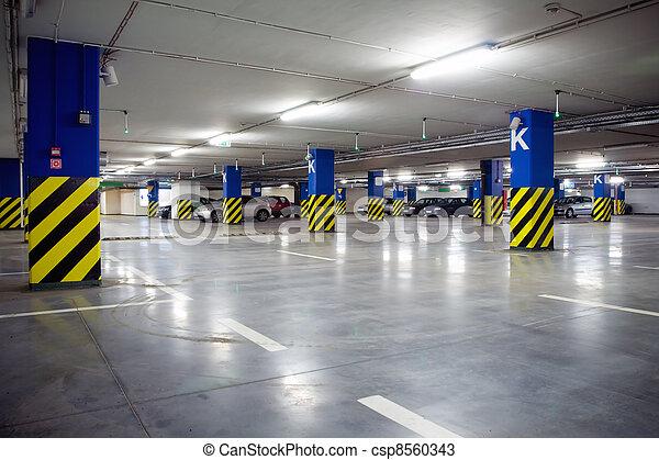 Parking garage of shopping center, underground interior - csp8560343