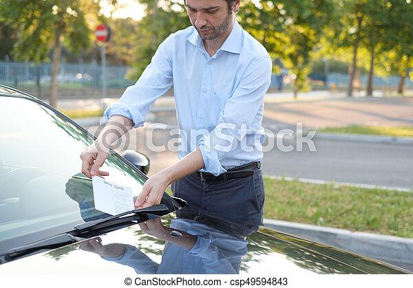 Parking violation ticket fine on windshield - csp49594843