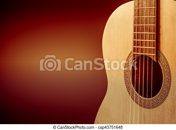 Part Of A Orange Acoustic Guitar On Black Background Part Of A
