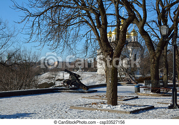 part of the alley in the Val park, with the cannon and the church, Chernihiv, Ukraine - csp33527156