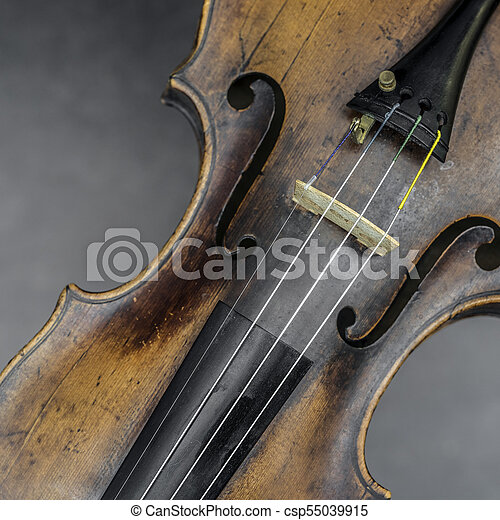 part of violin with f hole against gray background - csp55039915