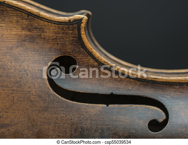 part of violin with f hole against gray background - csp55039534