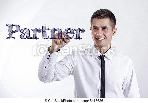 Partner - Young smiling businessman writing on transparent surface - csp45415636