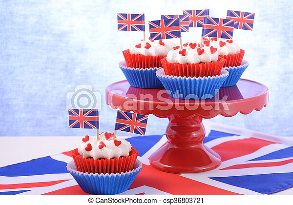 Holiday party cupcakes with UK flags on red cake stand with Union Jack flag.