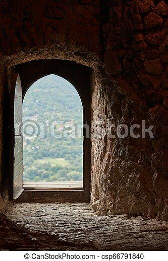 Passage of an old castle, open door - csp66791840