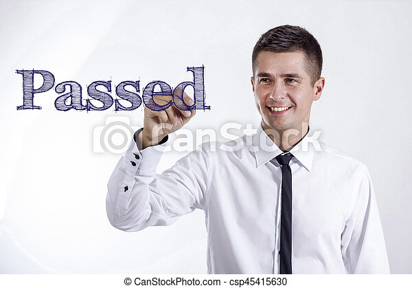 Passed - Young smiling businessman writing on transparent surface - csp45415630
