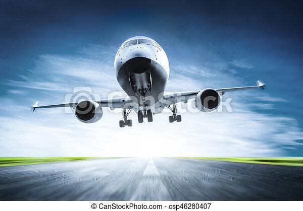 Passenger airplane taking off on runway - csp46280407
