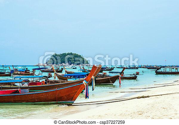 Passenger boats on the beach - csp37227259