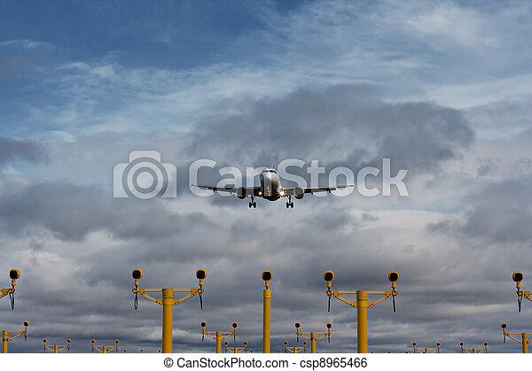 Passenger plane on final approach - csp8965466