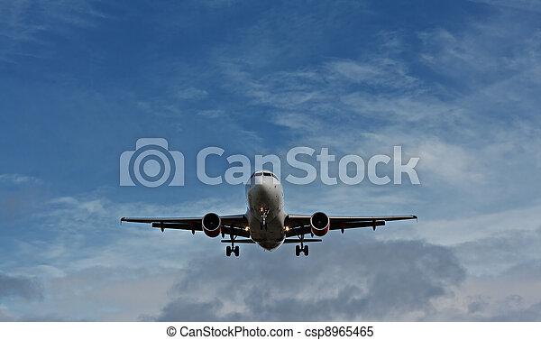 Passenger plane on final approach - csp8965465