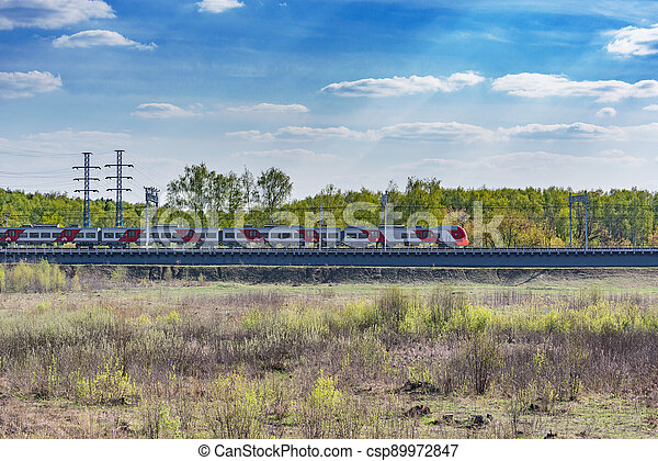 Passenger train moves on the bridge. - csp89972847