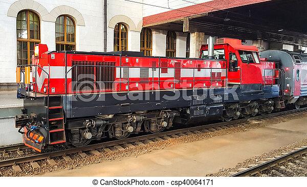 Passenger train on the station platform. - csp40064171