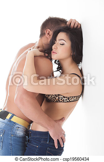 Passionate young lovers embracing in studio - csp19560434