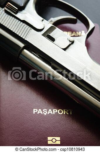 Passport and gun - csp10810943