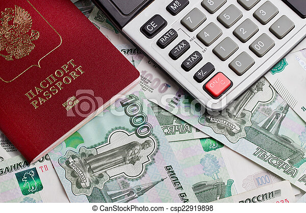 Passport and the calculator on a background of money - csp22919898
