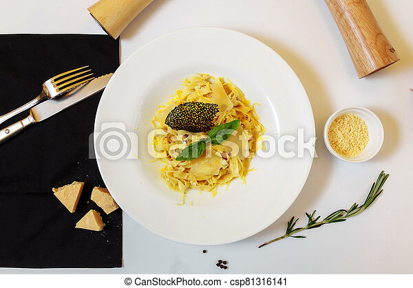 Pasta four cheeses. Homemade pasta, cream cheese sauce, Dor Blue, Cheddar, Parmesan, basil. Italian food. On a wooden background. Free space for text - csp81316141