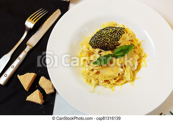 Pasta four cheeses. Homemade pasta, cream cheese sauce, Dor Blue, Cheddar, Parmesan, basil. Italian food. On a wooden background. Free space for text - csp81316139