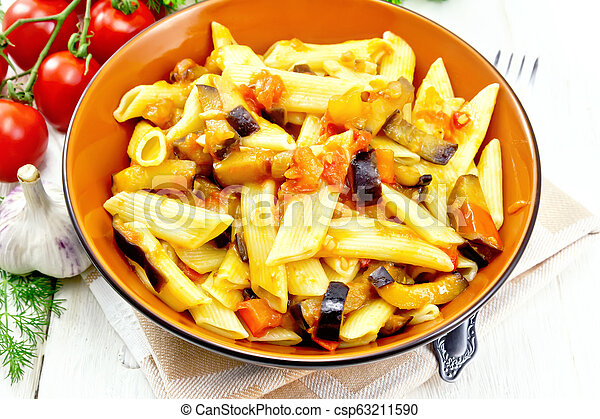 Pasta penne with eggplant and tomatoes on kitchen towel - csp63211590