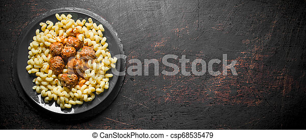 Pasta with meat balls on a plate. - csp68535479