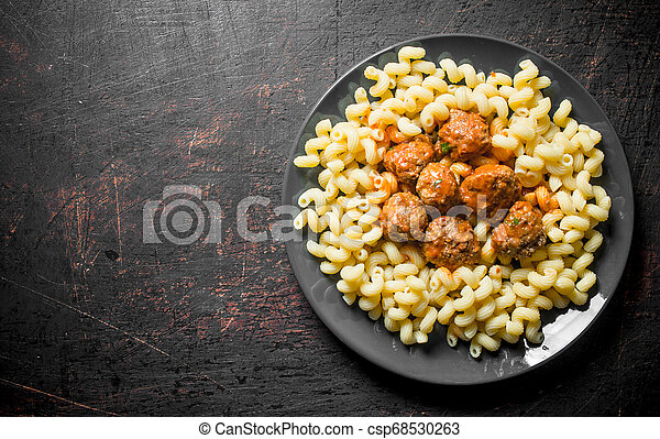 Pasta with meat balls on a plate. - csp68530263