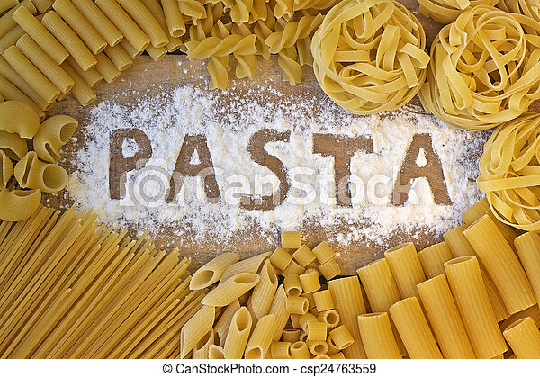 Pasta word with wood background - csp24763559