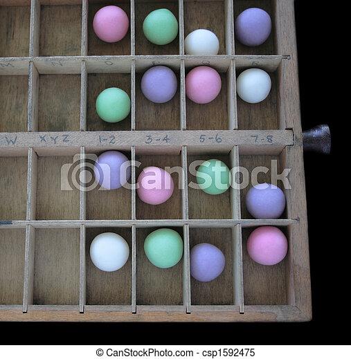 pastel balls in a type case - csp1592475