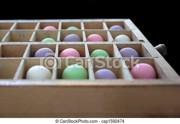 pastel balls in a type case - csp1592474